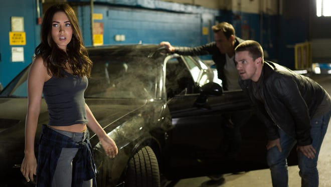 April O'Neil (Megan Fox), Vern Fenwick (Will Arnett) and Casey Jones (Stephen Amell) take a breather in 'Teenage Mutant Ninja Turtles: Out of the Shadows.'