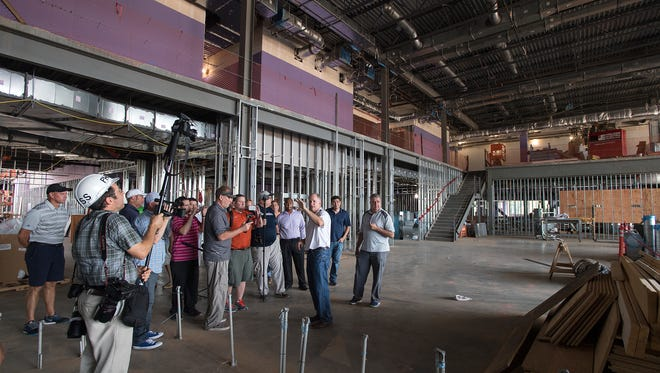Clemson director of recruiting & external affairs Thad Turnipseed leads a group of the media through the PAW Dining Facility during a tour of ClemsonÕs new football facility on Saturday, August 13, 2016.