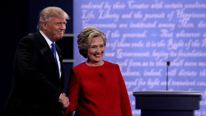 Democratic presidential nominee Hillary Clinton takes the stage with Republican presidential nominee Donald Trump during the Presidential Debate at Hofstra University on September 26, 2016 in Hempstead, New York.