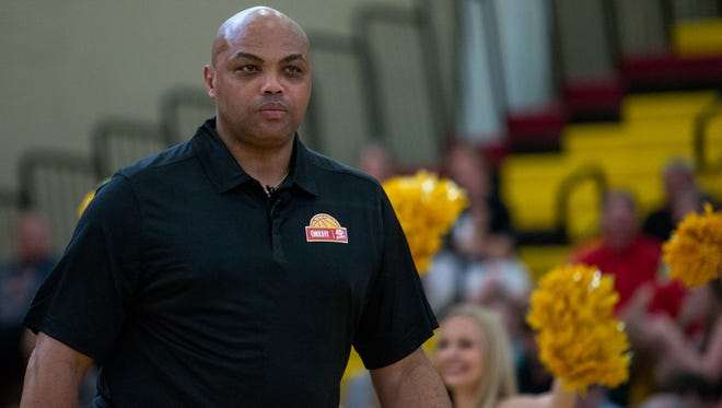 Charles Barkley walks onto the court before the Celebrity Crunch Classic basketball game at Chaparral High School in Scottsdale, Ariz., on Sunday, April 2, 2017.