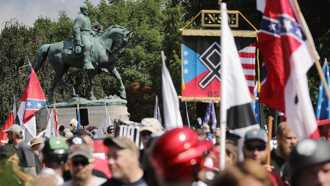 The statue of Confederate General Robert E. Lee stands behind a crowd of hundreds of white nationalists, neo-Nazis and members of the 'alt-right' during the 'Unite the Right' rally Aug. 12, 2017 in Charlottesville, Va.
