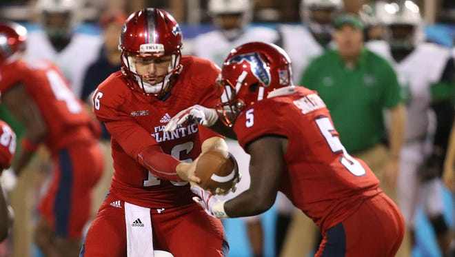 Florida Atlantic QB Jason Driskel hands the ball off to Devin Singletary in a recent game. The Owls won this weekend against Louisiana Tech.