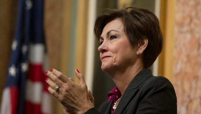 Gov. Kim Reynolds applauds during the Condition of the Judiciary speech by Chief Justice Mark Cady on Jan. 10 at the Iowa Capitol.