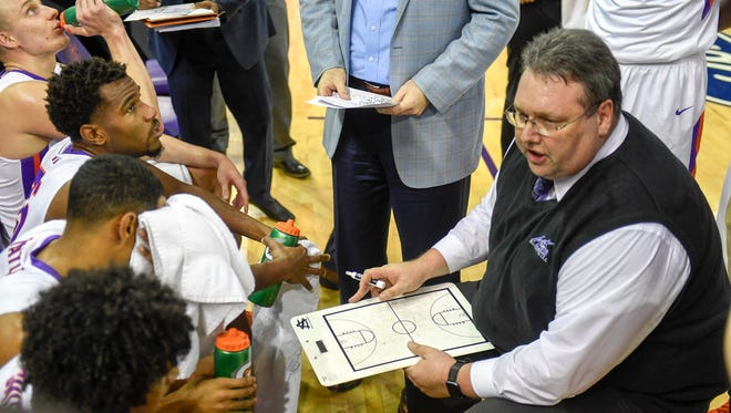 University of Evansville's  Head Coach Marty Simmons talks to his team during a time-out as the University's of Evansville Purple Aces play the Missouri State Bears at the Ford Center Wednesday, January 10, 2018.