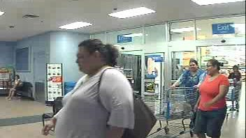 Surveillance image of a woman accused of stealing a wallet at a McDonald's