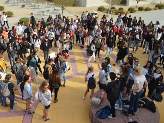 Students gathered Wednesday, March 14, 2018, at a Zia