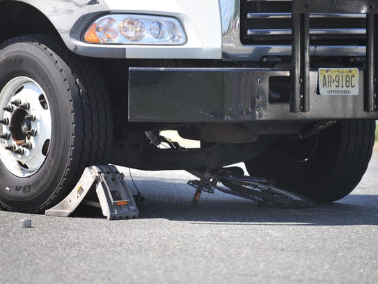 A bicycle is pinned under a commercial truck on Delsea