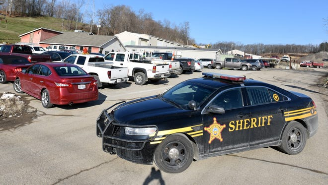 A cruiser from the Muskingum County Sheriff's Office sits outside the Muskingum County Engineer's Office Thursday morning. The State Auditor's Office is investigating the Engineer's Office for improprieties.