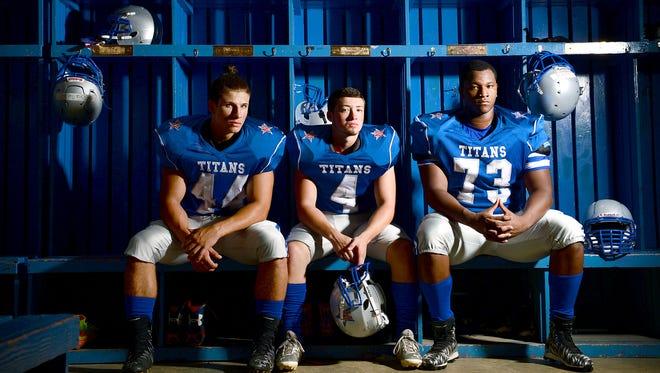 McDowell football players Ishman Martino, Tyler Banks and Isaiah Burch.