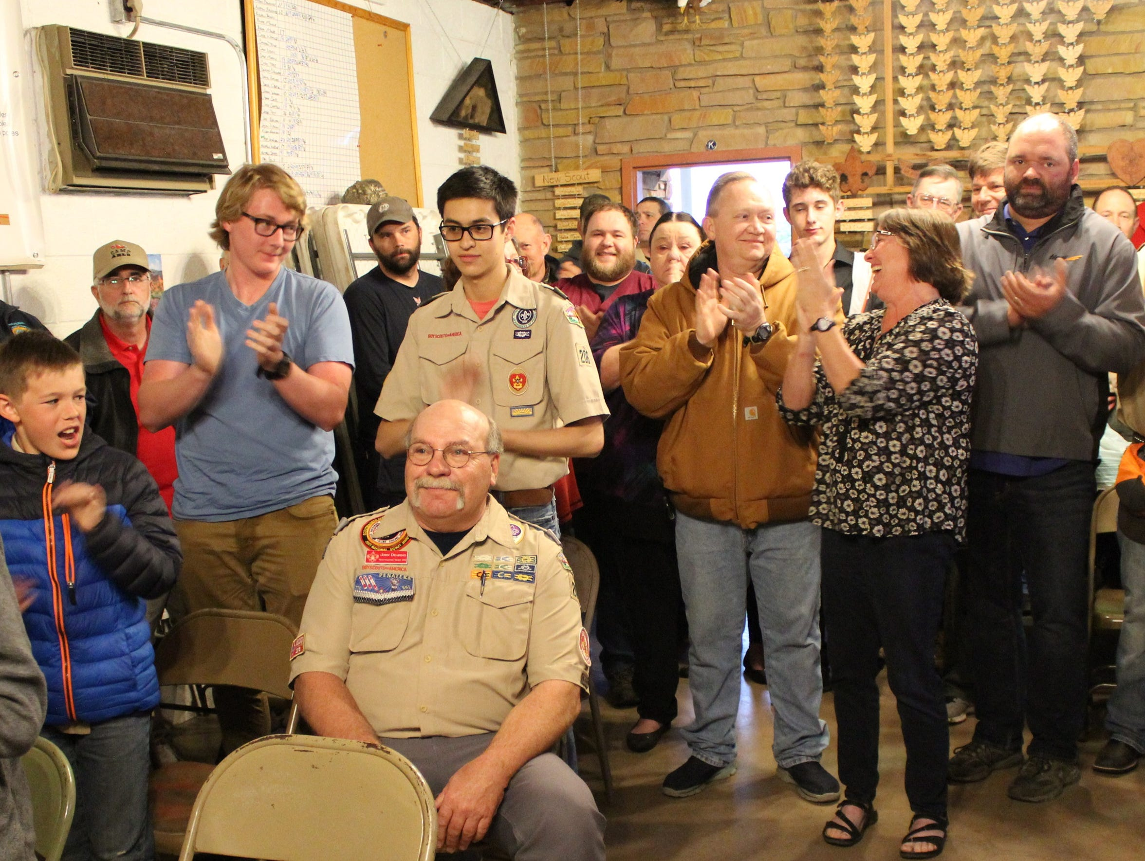 Dr. John Dearing, who is stepping aside from Boy Scout Troop 206 leadership after more than 20 years, drew a standing ovation Tuesday evening when he was recognized during a Court of Honor.