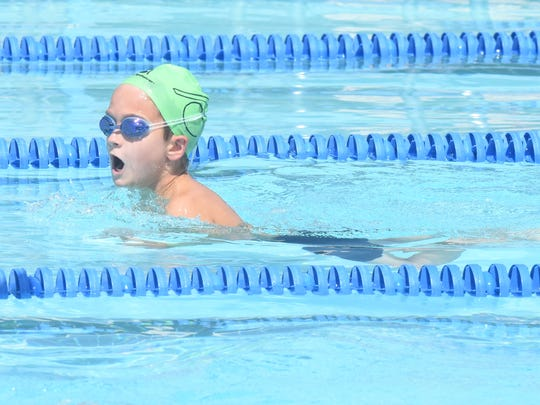 Mountain Home's Strat Rucker swims the boys' 10-and-under 50-meter breaststroke event Saturday at Cooper Park.