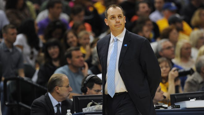 Indiana Pacers coach Frank Vogel walks on the sidelines in the first quarter as the Indiana Pacers lost to the San Antonio Spurs 103-77 at Bankers Life Fieldhouse March 31, 2014.