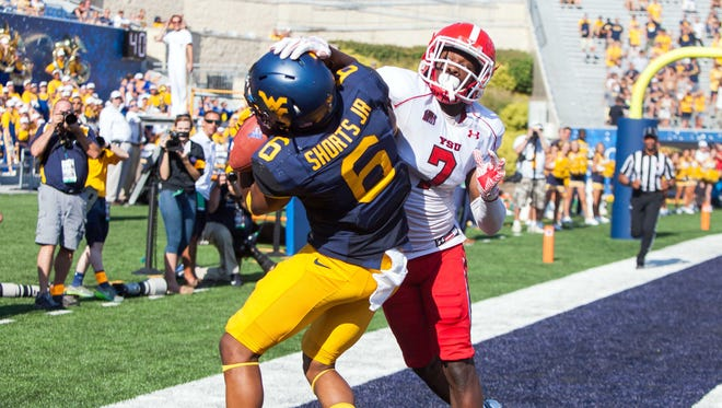 West Virginia Mountaineers wide receiver Daikiel Shorts (6) catches a touchdown over Youngstown State's Kenny Bishop during the third quarter against the Youngstown State Penguins at Milan Puskar Stadium on Sept. 10, 2016.