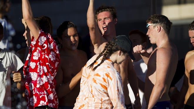 Brophy's swim team reacts after winning a race during the Division I state swimming and diving championships at the Skyline Aquatic Center in Mesa on Saturday, Nov. 5, 2016.