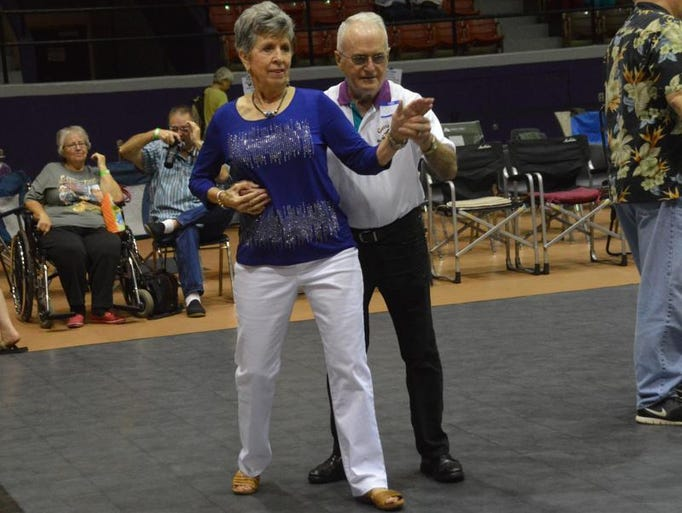 ANI NSU Folk Festival Bobbie Keyes (left) of West Monroe and Tom Johnson of Rayne dance to Cajun music at the Natchitoches Folk Festival held Saturday, July 19, 2014 at Prather Coliseum on the NSU campus.