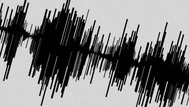 Abstract black seismogram on white paper background