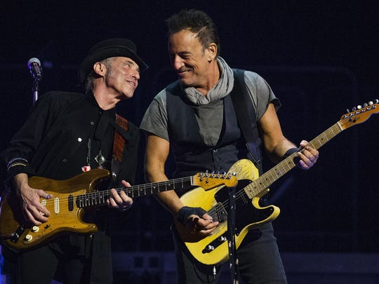 Bruce Springsteen plays with bandmate Nils Lofgren