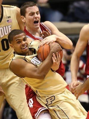 Purdue Boilermakers guard P.J. Thompson and Indiana Hoosiers guard Nick Zeisloft go after a loose ball in the second half. Purdue hosted Indiana at Mackey Arena Wednesday, January 28, 2015.