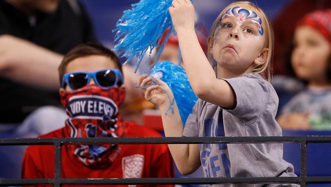 Young Indy Eleven fans cheer on their team in the first half of their game at Lucas Oil Stadium on Saturday, March 31, 2018.