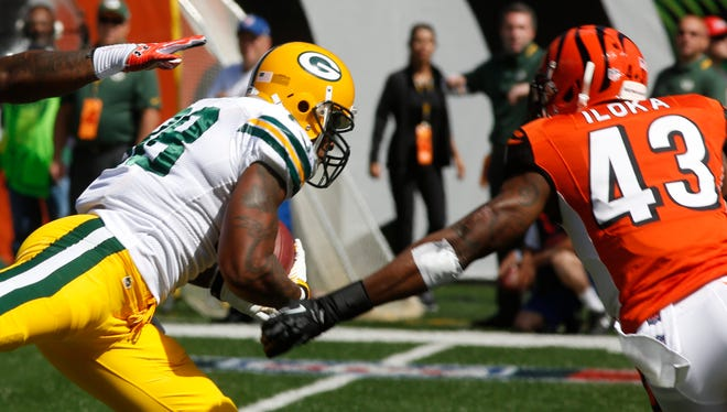 Packers TE Jermichael Finley was concussed by a hit from Bengals S George Iloka (43) Sunday.