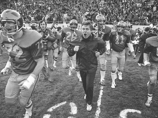 Nov. 20, 1977: The exultation that comes with knocking off an unbeaten team is mirrored on the face of Delaware football coach Tubby Raymond as leads his happy Blue Hens off the field after yesterday's victory over Colgate.