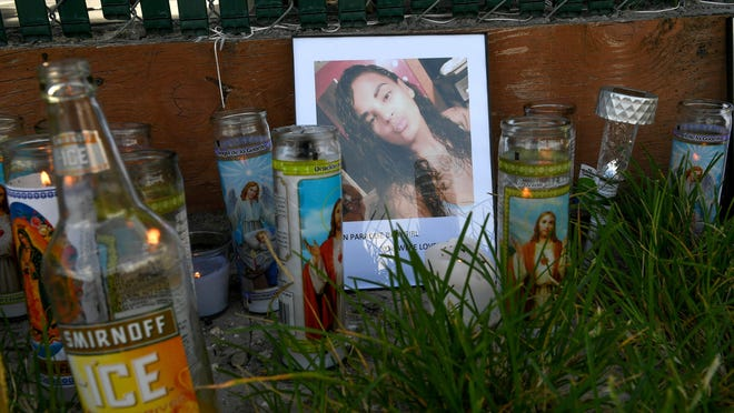 Several dozen candles flicker in the morning light around a portrait of Maribel Morales-Rosado, at a memorial in front of her home on Wednesday, Aug. 12, 2020, where she was shot multiple times by her ex-boyfriend, Donald L. Williams according to Martin County Sheriff William Snyder, on Tuesday, and died from her injuries.