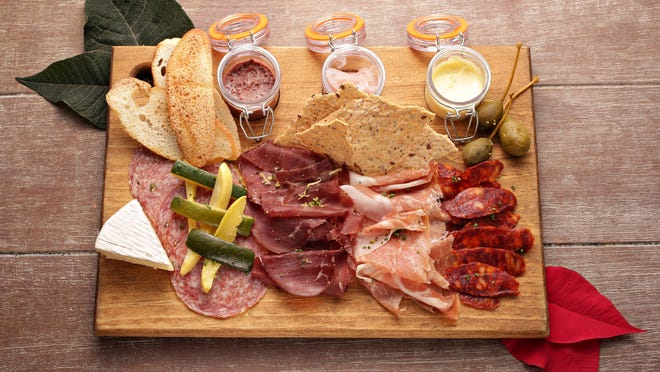 Prosciutto, sopprasata, bresola and chorizo are options for a charcuterie board, like this one from the Market at Jennifer's. Don't forget homemade violet mustard, shallots and garlic aioli.