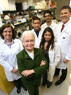 UTEP President Diana Natalicio, foreground left, posed with researchers Vanessa Lougheed, left, and Robert Kirken, standing right, and research students Oscar V. Torres, right of Natalicio, Luis Natividad, center background, and Rocio Avila.