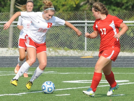 Richmond's Jordan McGuire (28) moves against the defense of Jay County's Kyra Braun on Tuesday at Lyboult Field.