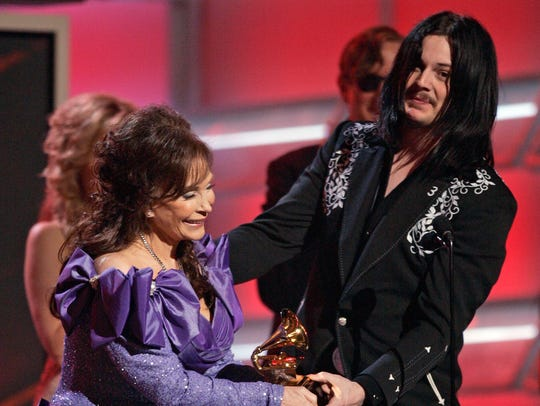 At left: Loretta Lynn accepts the award for best country