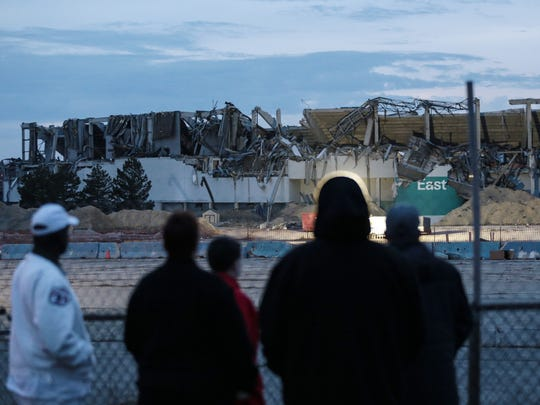 People survey the scene of the second implosion at the Pontiac Silverdome in Pontiac on Monday December 4, 2017.