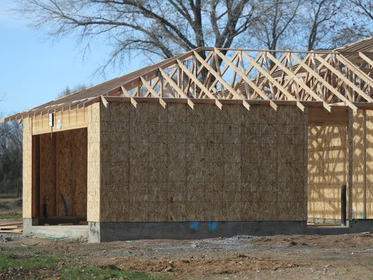 A house is being built on Sadie Lane in Cottonwood through a program in which homebuyers put in sweat equity building their and their neighbors' homes as their down payment.