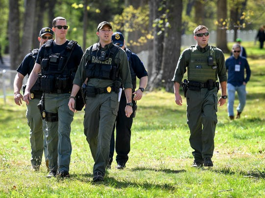 Park Rangers are joined by law enforcement to patrol the park where anti-racist organizations gather to protest the  annual American Renaissance conference at the Montgomery Bell State Park in Burns, Tenn., Saturday, April 28, 2018.