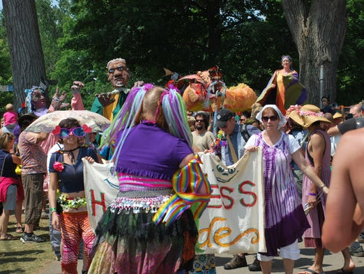Festival goers at this year's Finger Lakes GrassRoots Festival of Music and Dance take part in the Happiness Parade on Sunday, a tradition that takes place on the last day of the festival.