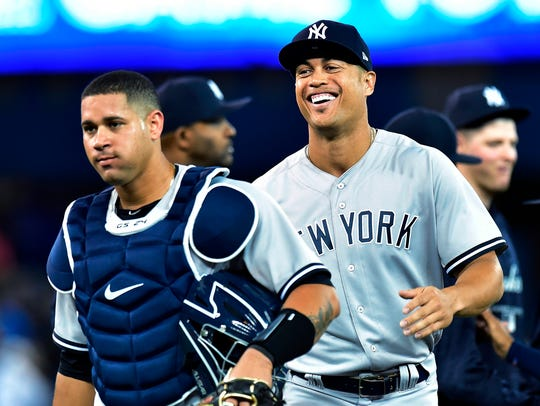 New York Yankees right fielder Giancarlo Stanton, right,
