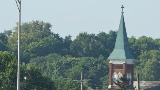 The steeple of St. Ann Catholic Church in Lafayette.