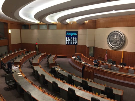 Final preparations are made on the floor of the New Mexico House of Representatives in Santa Fe, N.M., Friday, Jan. 13, 2017, in anticipation of the legislative session. Lawmakers are confronting budget shortfalls, frustration over a weak economy, and concerns about violent crime and school performance as they convene Tuesday, Jan. 17.