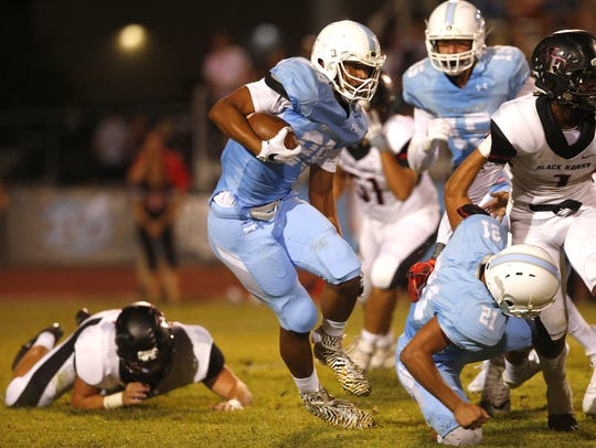 Deer Valley Dez Melton, #88,  carries the ball during
