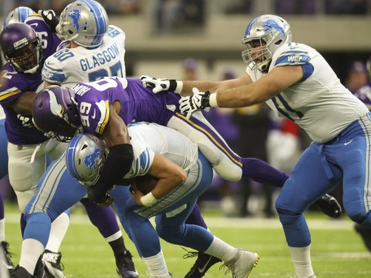 Lions offensive tackle Rick Wagner, right, can't prevent