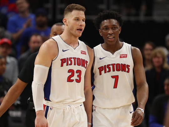 Blake Griffin, left, and Stanley Johnson talk late in the fourth quarter of the Detroit Pistons' 104-102 win over the Memphis Grizzlies at Little Caesars Arena on Thursday, Feb. 1, 2018.