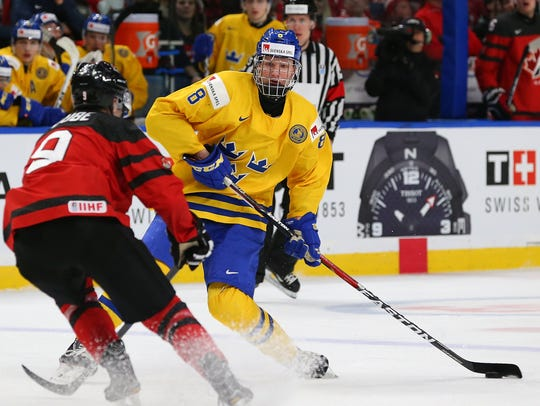 Swedish defenseman Rasmus Dahlin , shown going against