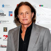 FILE - In this Sept. 11, 2013 file photo, former Olympic athlete Bruce Jenner arrives at the Annual Charity Day hosted by Cantor Fitzgerald and BGC Partners, in New York. ABC 's Diane Sawyer interviewed the former Olympic champion and patriarch of the Kardashian television clan in a two-hour interview on Friday, April 24. (Photo by Mark Von Holden/Invision/AP, File)