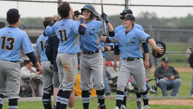 Cape Henlopen's Celebrates after two runs score against Sussex Tech during the match up on Monday. Megan Raymond Photo