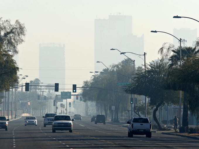 High rises in downtown Phoenix are obscured by smog