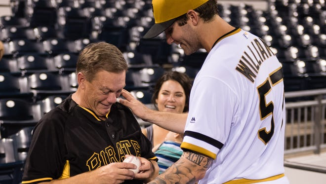 PITTSBURGH, PA - SEPTEMBER 07: Trevor Williams #57 of the Pittsburgh Pirates gives his father Richard Williams the game ball after getting his first Major League win as the Pittsburgh Pirates defeated the St. Louis Cardinals 4-3at PNC Park on September 7, 2016 in Pittsburgh, Pennsylvania.