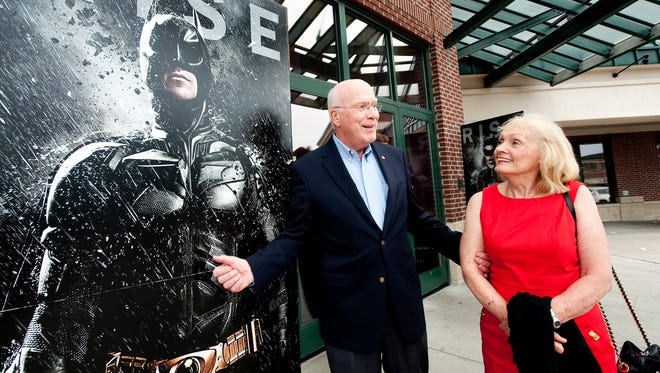 "Vermont senator Patrick Leahy and his wife Marcelle pause outside the movie theatre to check out the posters for the premiere of ""Batman, the Dark Knight Rises"" at the Majestic 10 on Sunday night July 15, 2012 in Williston, Vermont. The senator has a small part in the movie and held a reception before the screening."