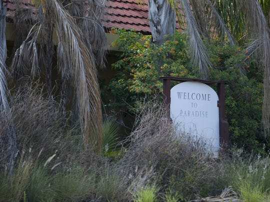 In this file photo, the welcome sign in front of the abandoned Paradise Preserve clubhouse and sales center in North Fort Myers welcomes no one. Paradise Preserve, formerly Lochmoor Country Club, has been closed for years due to foreclosure.