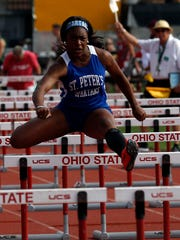 St. Peter's Alysse Wade repeated as Division III state champ in the back-to-back 100 meter hurdles and 100 meter dash.
