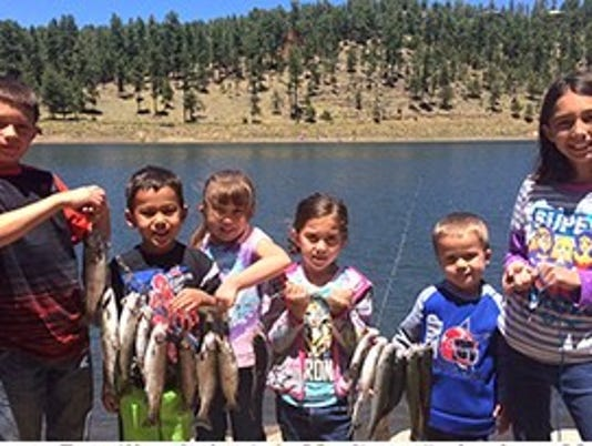 kids with their Alto Lake catch