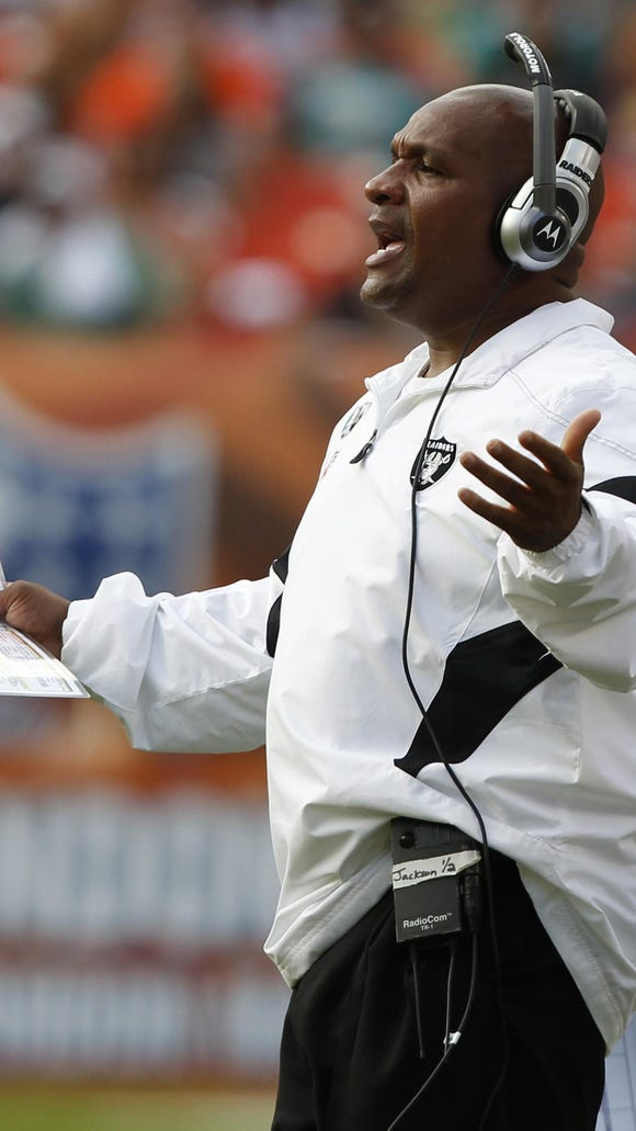 In this file photo, former Oakland Raiders head coach Hue Jackson gestures from the sidelines during a game against the Miami Dolphins in 2011.